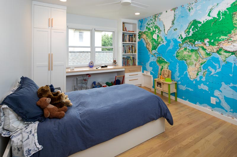 Stutts child bedroom with world map wallpaper